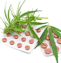 cannabis leaf with tablets.