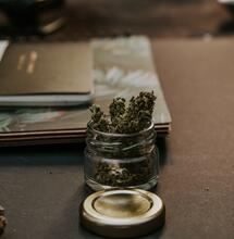 Jar of weed on a desk