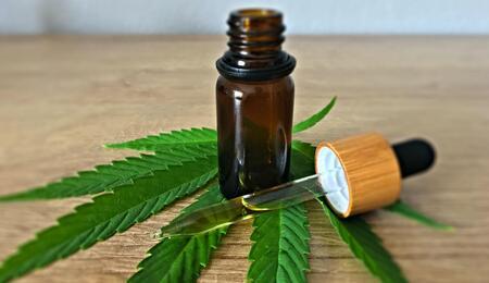 cbd oil with cannabis leaf.