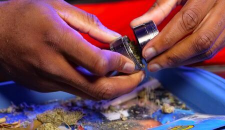 man emptying grinder
