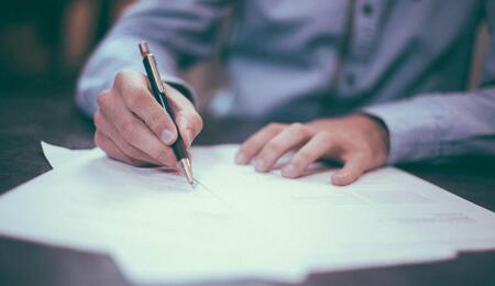 a lawmaker signing a bill.