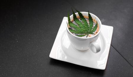 Tea cup with a cannabis leaf inside