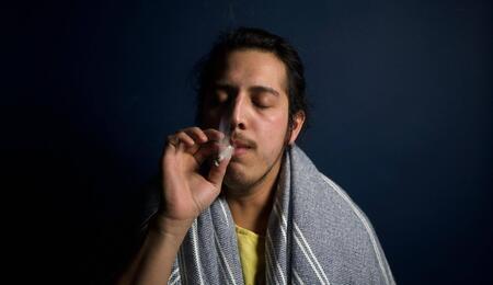 a young man smoking.