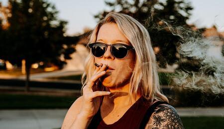 Blonde girl smoking pot.