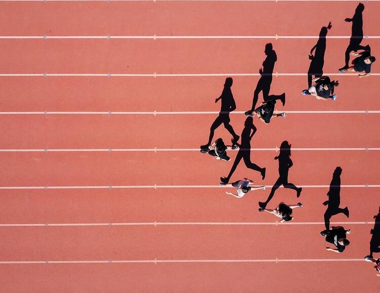 bird perspective of athletes running.